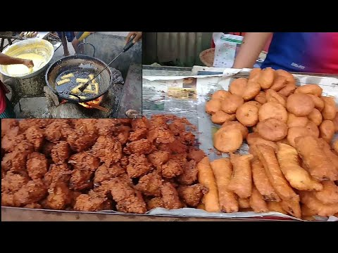 Romadan Iftar Market and making different items food. This is the femous food of bd Muslim people's.