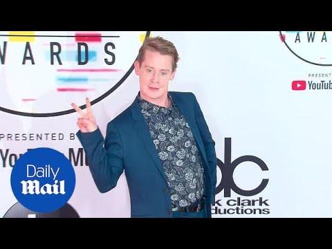 Macaulay Culkin wears blue suit & Converse sneakers to AMAs