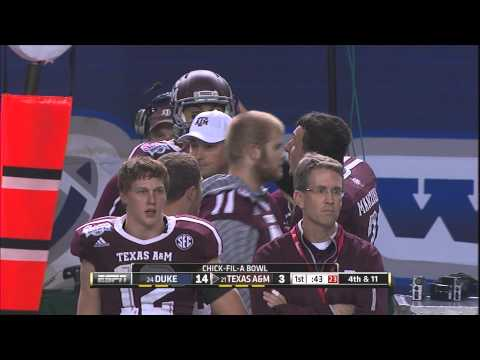 johnny-manziel-tries-to-calm-mike-evans-on-texas-a&m-sideline