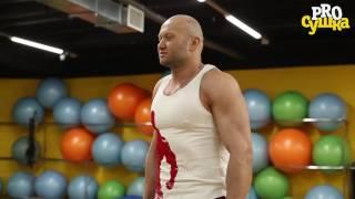 Шраги с гантелями стоя для развития трапециевидных мышц