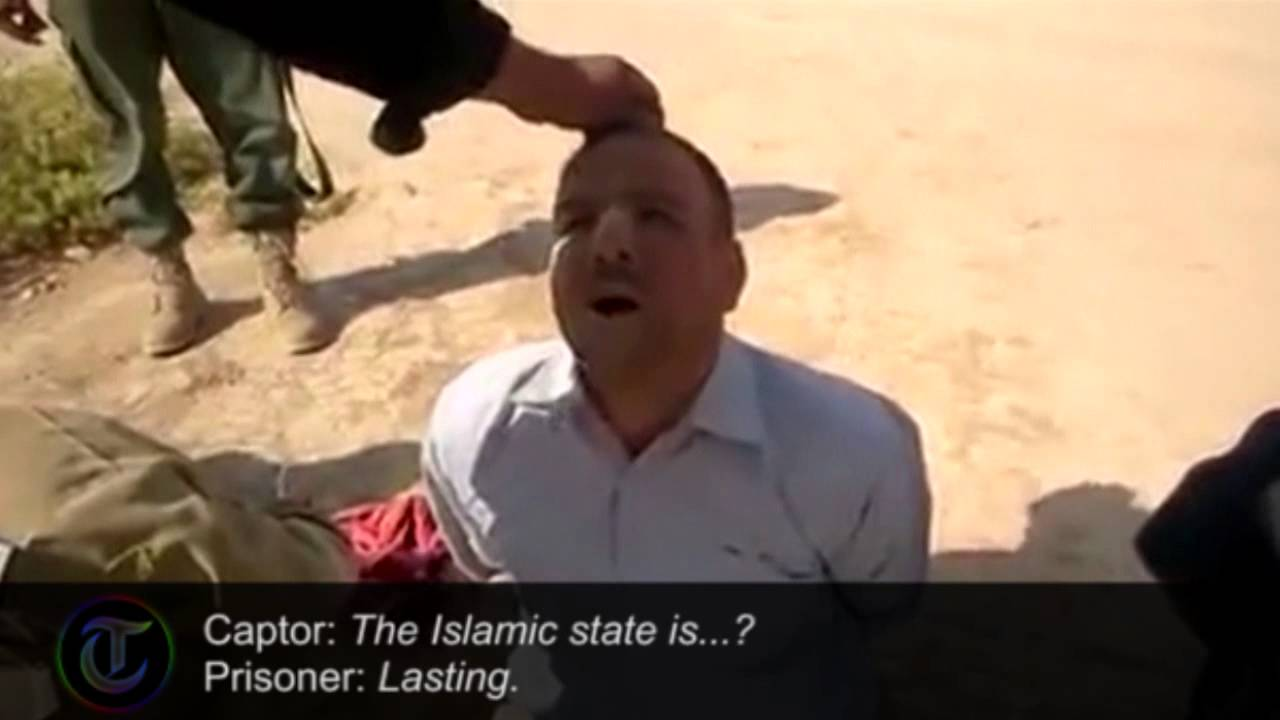 Iraqi soldiers brutally questioned and 'killed' in Isis