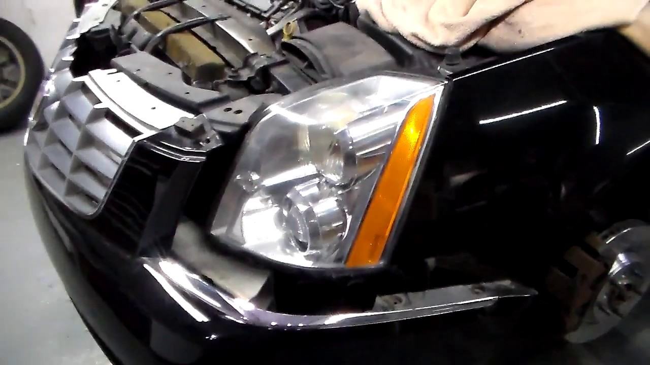 cadillac dts headlight replacement [ 1280 x 720 Pixel ]
