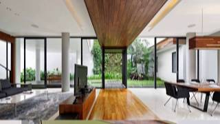 Beautiful Glass Enclosures Transform Smart Indonesian Home in Wood and Concrete