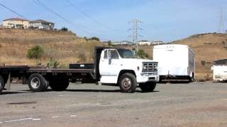 Lot 103 - 1990 GMC 7000 Flatbed Truck