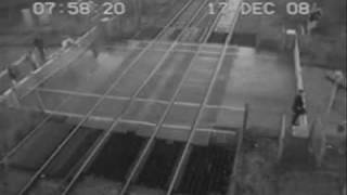 Man Dodges Train at level crossing - Shocking!! High Quality FULL