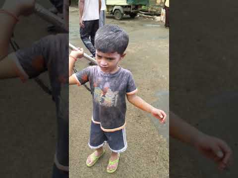 Littel kid playing lazim the traditional dance of maharashtra
