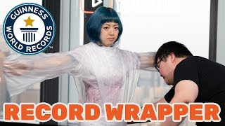 Fastest time to wrap a person in cling film - Guinness World Records Day 2018