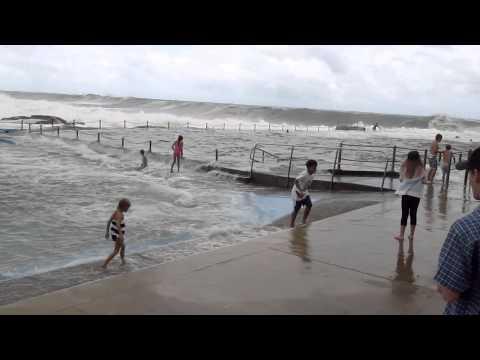 Kids in rock pool Dee Why big waves