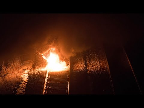 Demonstrators burn tire