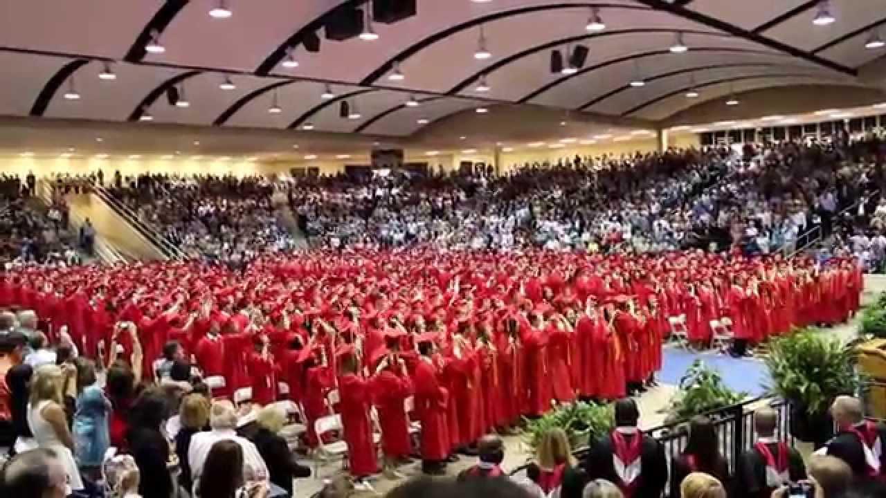 graduation caps thrown in air houston memorial high school 2014