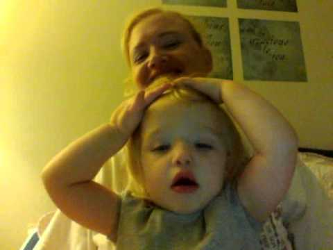 Little girl realizes she can see herself on the webcam. Funny