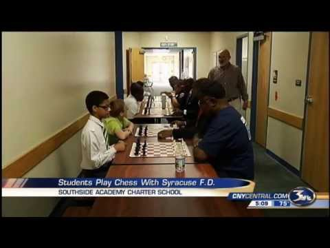 Southside Academy Charter School Students Play Chess with the Syracuse Fire Department