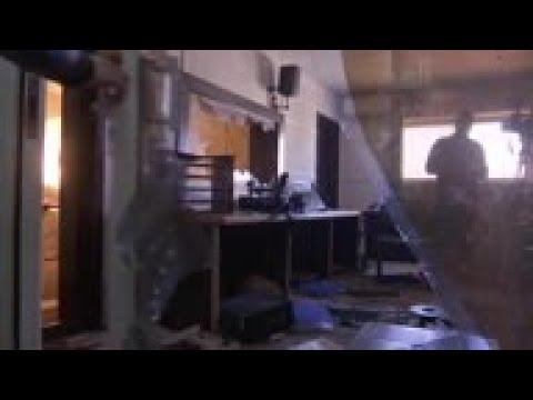 Palestine / Israel / Vietnam - Gunmen raid Palestinian TV office in Gaza / Israel erects steel barri