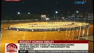 Guinness World Record: The Largest Human Smiley was achieved by 8,018 AIM Global Distributor