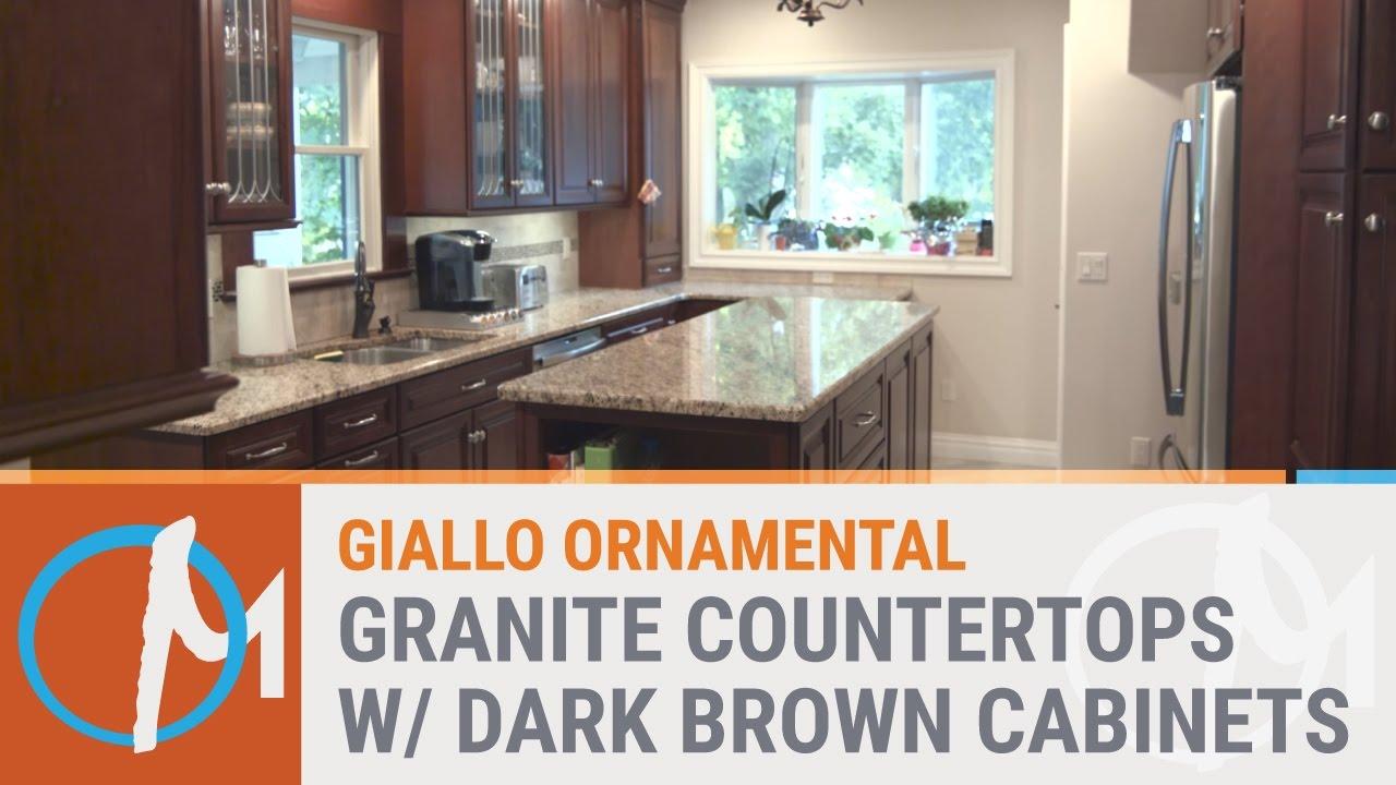 Giallo Ornamental Granite Countertops With Dark Brown Cabinets