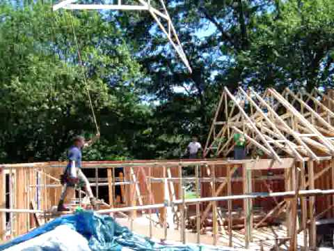 Contractor installing roof trusses youtube for Roof trusses installation