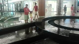 Lia watching the fountain at al ghurair city dubai