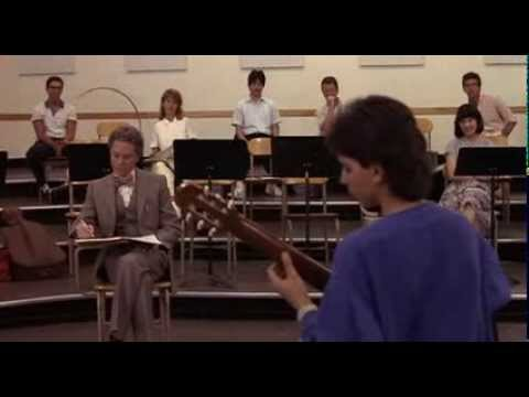 Ralph Macchio on guitar