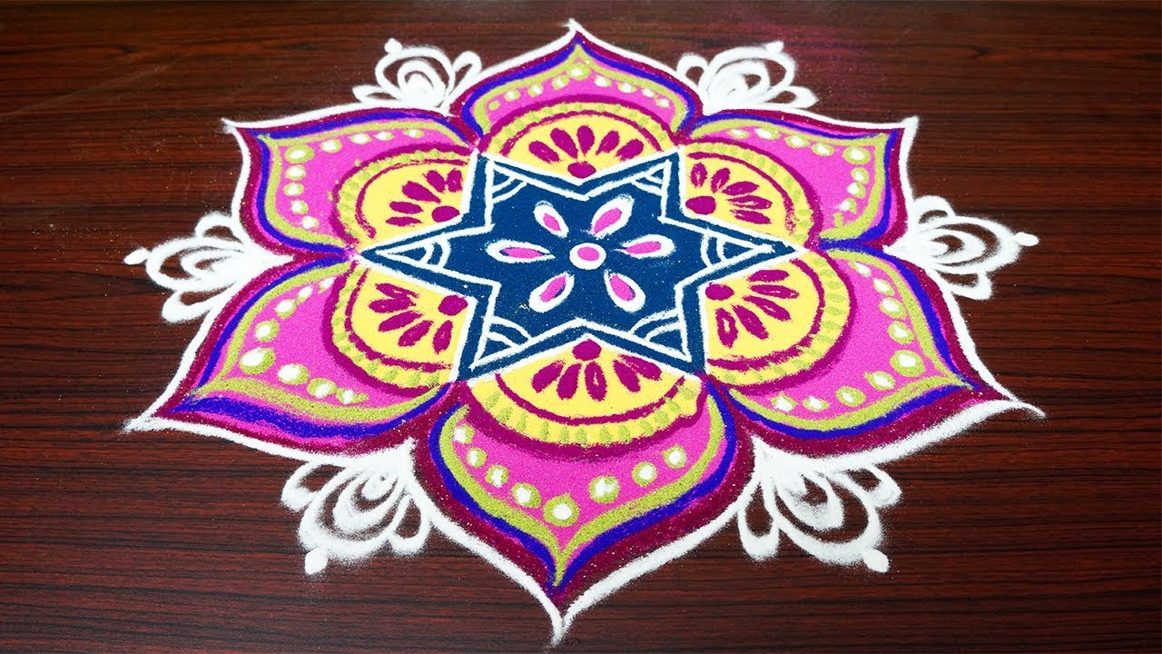 beautiful color rangoli designs with 7x4 dotssimple