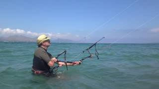 first hour kitesurfing lessons in Mallorca in May kite control italian guy
