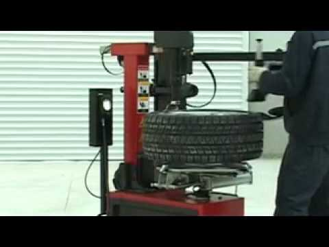 tilting tire changer with right arm helper