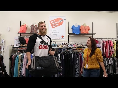Rugby player Brad Shields stops by a Red Cross Shop
