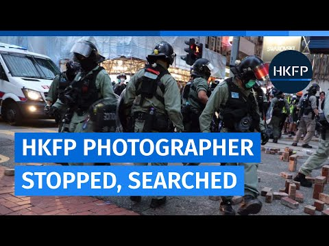 HKFP freelance photographer May James stopped and searched by police
