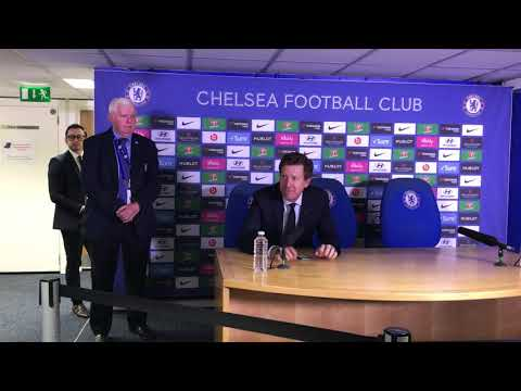 Chelsea chairman Bruce Buck presents Brian Pullman with cake and flowers at Stamford Bridge