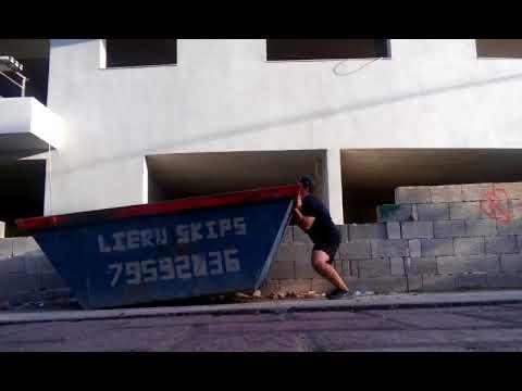 Lifting a large iron skip overhead