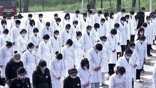Траур по погибшим от коронавируса в Китае
