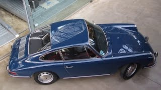 Parking a classic Porsche 912 while holding an unlidded cup of coffee