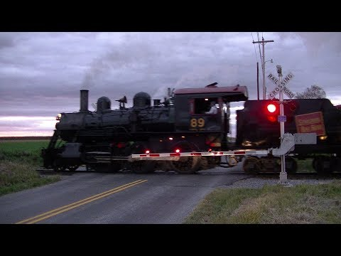 Vintage steam train passes through newly upgraded crossing