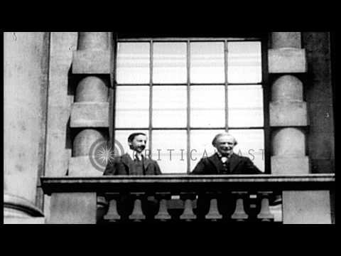 Britain's Prime Minister David Lloyd George on a balcony with another official in...HD Stock Footage