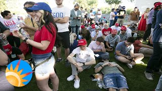 Trump supporters don't mind the risk of COVID as they wait for the President's Phoenix arrival.