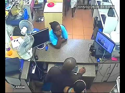 03 - Woman distracts shop assistant while kid steals phones - 26 February 2015