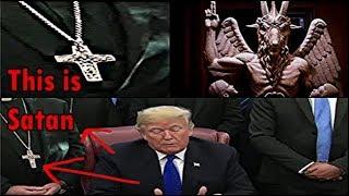Donald Trump - Owned by The Vatican? Men in Black behind Trump wearing Baphomet Crosses!!