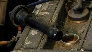 How to Remove Oil From a Spark Plug Well : Car Repair Tips