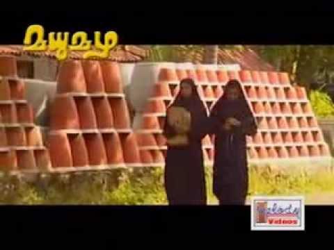 mozhicholli piriyumbol     madhumazha song ,