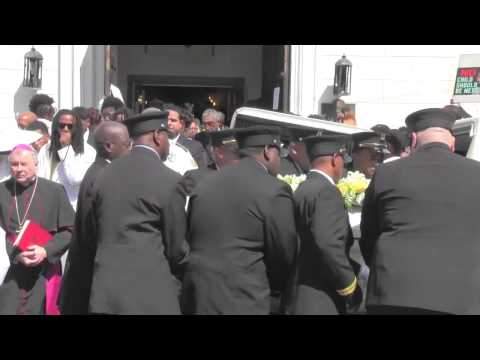 Mayor Mitch Landrieu speaks at funeral services for Milan Arriola