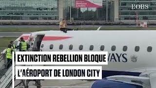 Un militant d'Extinction Rebellion monte sur un avion à l'aéroport de Londres City