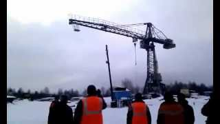 Crane Collapse! Кран упал! (www.vertikalnet.ru)(Safe to Start at 0.45 mark. This Tower Crane Collapse does not appear to be an accident, but pulled down from a cable barely visible to the left of the video., 2012-06-22T11:03:14.000Z)