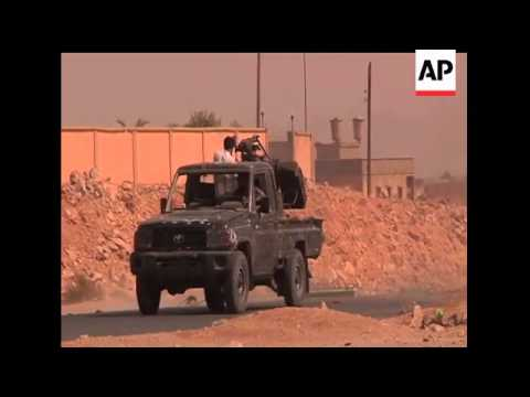 The Associated Press is at the front to document Libyan Revolutionary forces attempt to take one of