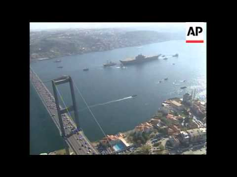Giant half built aircraft carrier pulled through Bosporus.