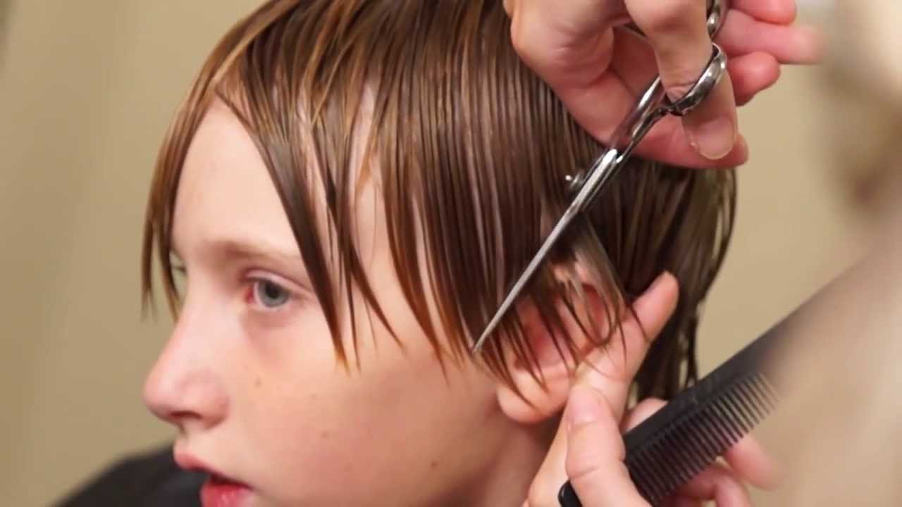 teenage boy getting a hair cut