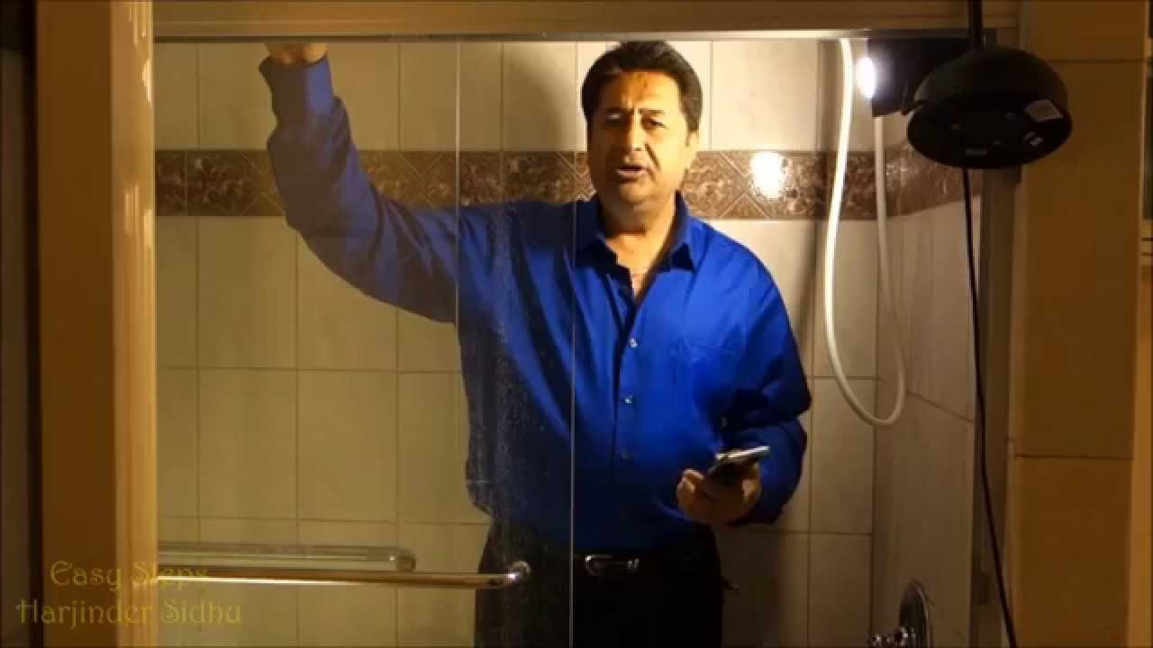 Tips tricks how to clean glass shower doors remove hard water tips tricks how to clean glass shower doors remove hard water stains remove calcium build up youtube planetlyrics
