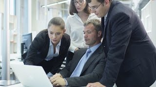 Office Workers Have Discussion next to Computer | Stock Footage - Videohive