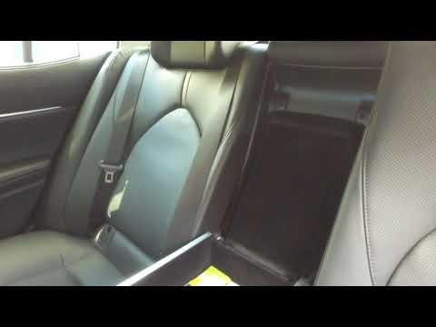 Новая Toyota Camry: Модифицируем подлокотник заднего дивана.