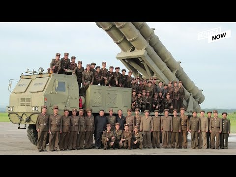 N.Korean leader Kim Jong-un joins a group photo  after super-large rocket launcher was tested