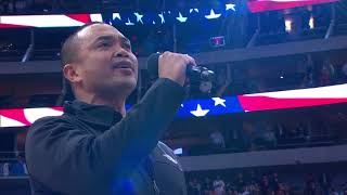 Jose Llana of The King and I sings the national anthem at a Dallas Mavericks home game