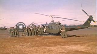 United States 1st Aviation Brigade soldiers briefed at an airfield in Cambodia HD Stock Footage